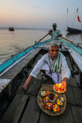 Joel Simpson: Ganges Diya Seller, Varanasi, India