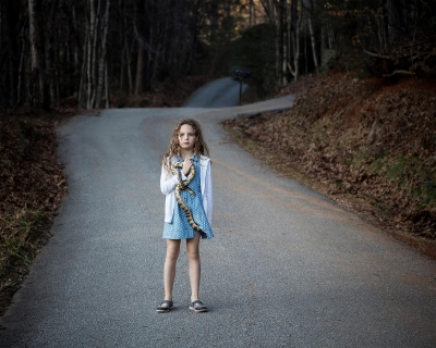 Jennifer Garza-Cuen: Girl with Snake, Rabun, GA