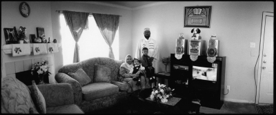 Paul Greenberg: Suadanese Family in their Apartment, from the series Immigrants