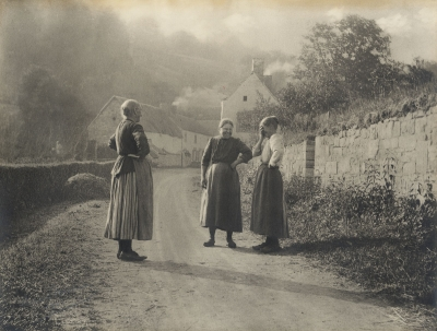 Leonard Misonne: Country Women Stopping to Converse on a Village Road in Belgium