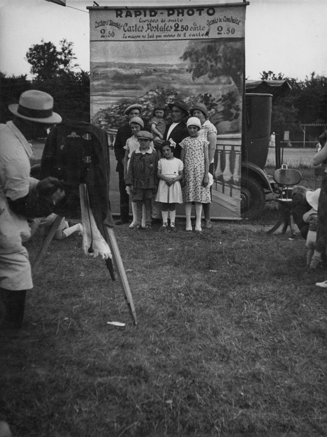 Unknown: Rapid-Photo Photographer Takes Photo of Family in Front of Backdrop, 1930s