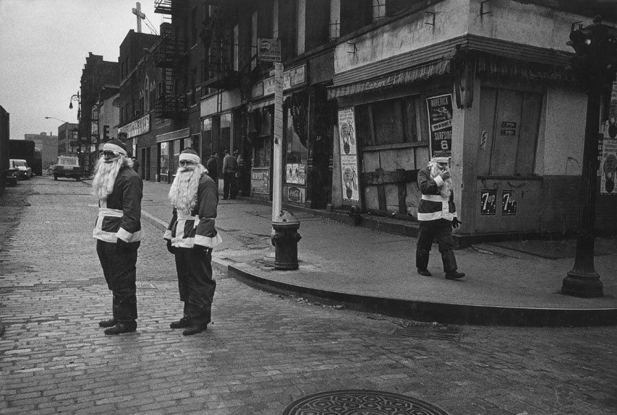 Susan McCartney: Santas on Houston Street, NYC, 1964