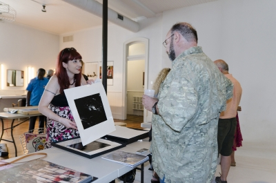 Kimberly Schneider presents her work to fellow photographer - and noted psychologist - Howard Waxman. Photo: Stephen Perloff.