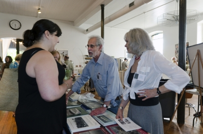 University of the Arts Photography Program head Anne Massoni chats with Michael A. Smith and Paula Chamlee who were presenting their work and books by their imprint, Lodima Press. Photo: Stephen Perloff.