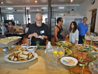 Photographer Ed Vatza samples some of the delicious food provided by Drew Bonacci. Photo: Gary Saretzky.