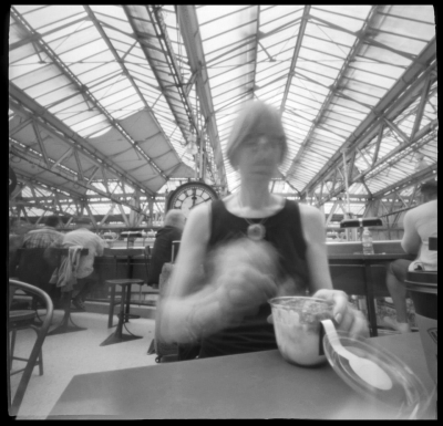 "Nancy Breslin: 8-4-16. Lunch at Benugo, Waterloo Station, London. 5 sec. pinhole exposure. From the series ""Squaremeals: A Pinhole Diary of Eating Out."""