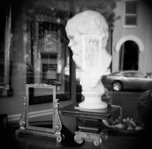 Eric Lindbloom: Window Shopping — Socrates in Hudson NY, 2012